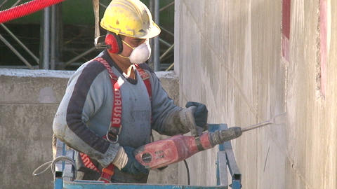 Work Cutting Concrete with a Pneumatic Hammer Live Action