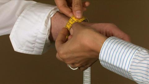 Tailor Wrist Measuring stock footage