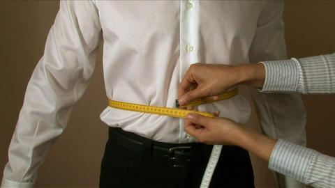 Tailor Waist Measuring stock footage