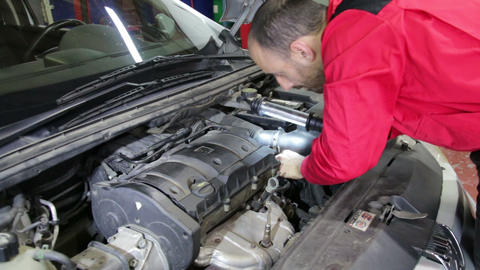 Car Repair Looking for Damage Live Action