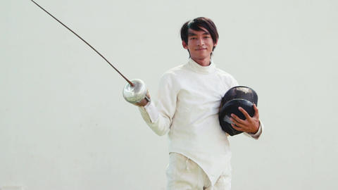 Portrait Of Young Asian Man Fencing GIF