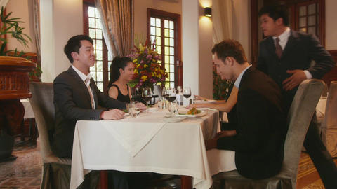 Waiter Serving Food To Clients In Restaurant Footage