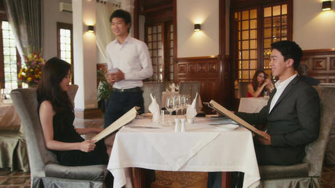 Young Couple Eating In Luxury Restaurant Stock Video Footage