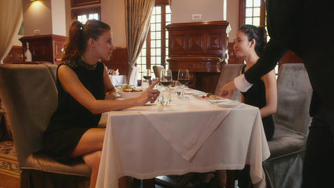 Female Friends Talking In Restaurant Footage