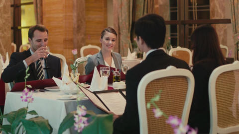 Group Of Friends Dining In Luxury Restaurant Footage