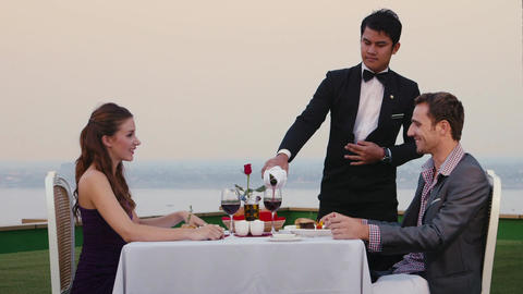Honeymoon With Married Couple Dining In Restaurant Footage