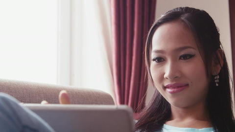 Asian Woman Using Tablet For Social Network And In stock footage