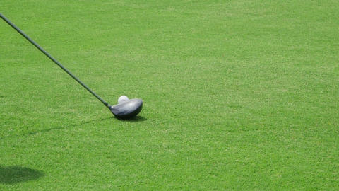 Closeup Of Golf Bat Hitting Ball On Grass stock footage