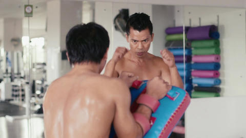 Asian Man Training For Kickboxing Martial Arts Combat Sport Footage