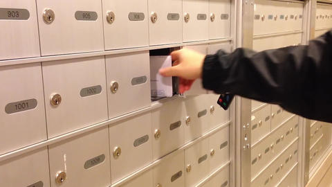 Man Taking A Mail From His Mailbox stock footage