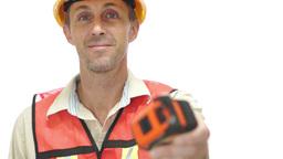 Male Tradesman Passing Tape Measure Footage