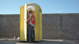 Male Construction Worker Portable Bathroom Footage