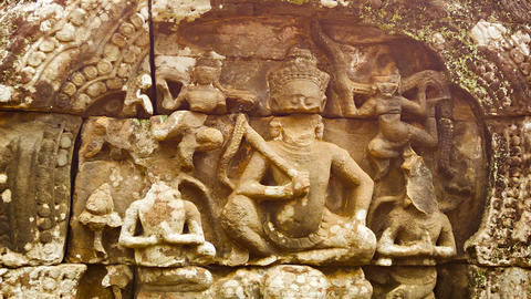 Carving on the wall of ancient temple. Angkor. Cam Footage