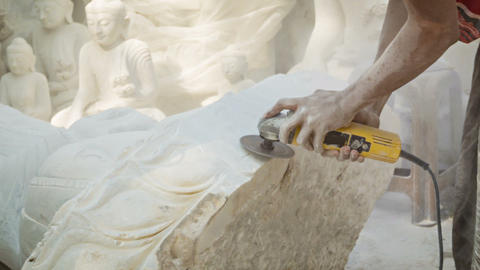 Processing marble Buddha statue in the workshop Footage