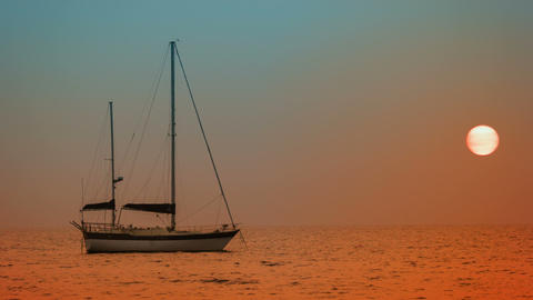 Yacht at anchor in the bay. Sunset on the tropical Footage