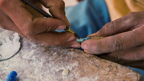Making miniature stone figurine. workshop in Cambo Footage
