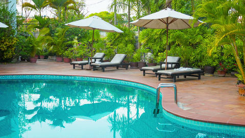 Sunbeds and umbrellas around the pool at the hotel Footage