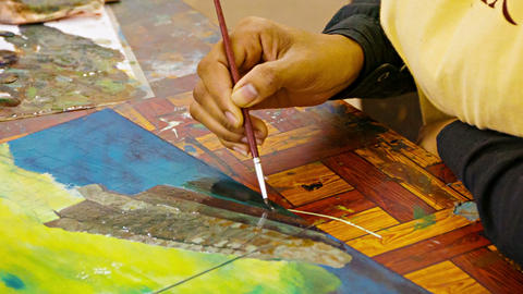 Artist paints a picture with oil paints. Cambodia Footage