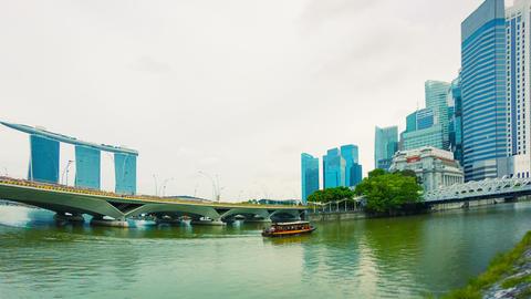 Pleasure boat in the river near bridges. Singapore Footage