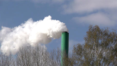 A green pipe producing white smoke Footage