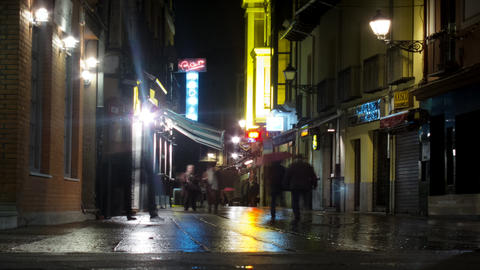 People walking in the rain at night. Time lapse. A Footage