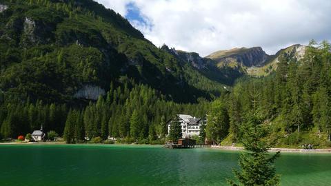 4k UHD pan over lake prags in dolomites alps 11518 Footage