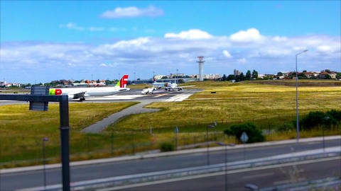 Planes Waiting ok to take off in Lisbon Airport Live Action