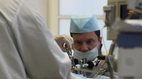 Doctor During Surgery Teamwork stock footage