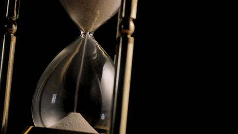 Hourglass rotating infront of black background Stock Video Footage