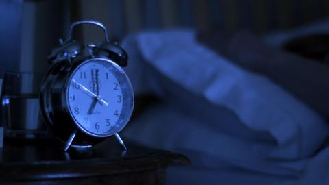 Woman woken up by alarm clock Footage