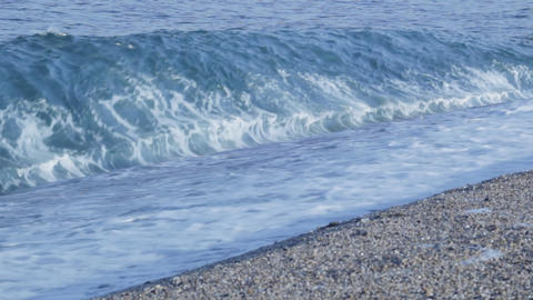 Waves breaking on beach Stock Video Footage