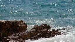 Waves splashing the rocky coastline Stock Video Footage