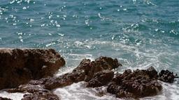 Waves splashing the rocky coastline Footage