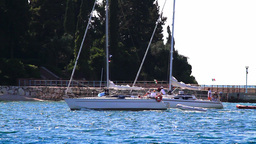 Lagoon in Croatia, small boats passing Stock Video Footage