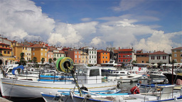 Boats in Rovinj Harbor, time-lapsed clouds Stock Video Footage