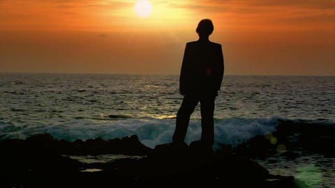 business man reach fists sundown sky slowmo Stock Video Footage
