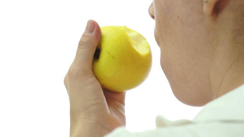 Female Eating Apple Over Shoulder stock footage