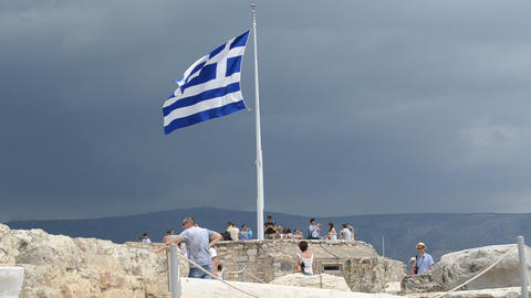 Flag of Greece waving in the Acropolis, Athens, Gr Footage