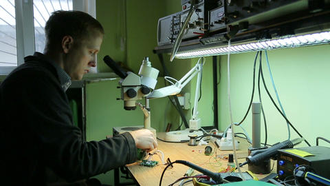 Scientist in laboratory parses the device Footage