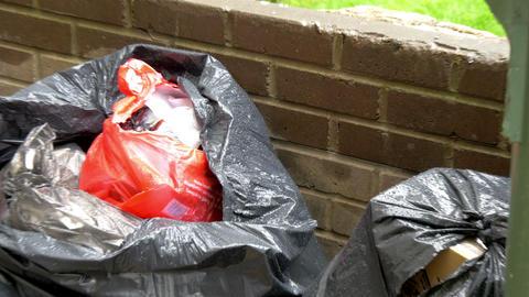 A black trash bag with garbage GH4 4K Live Action