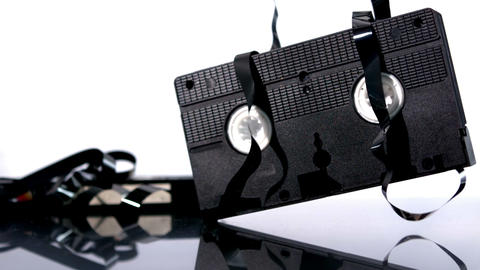 Video Tape Falling And Bouncing On White Backgroun stock footage