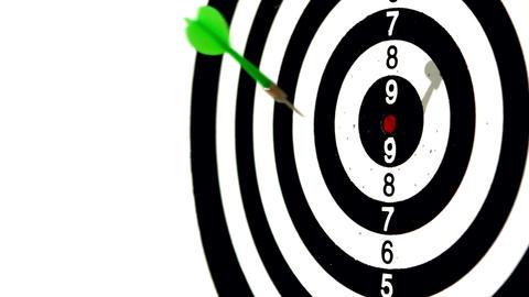 Green dart hitting the bullseye on white background Footage