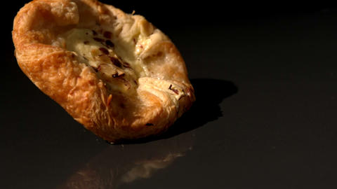 Pastry Snack Falling On Black Background stock footage