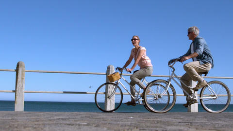 Senior Couple Going On A Bike Ride In The City On  stock footage