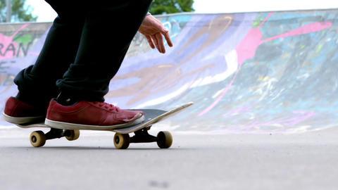 Young skateboarder skating the outdoor skatepark Footage