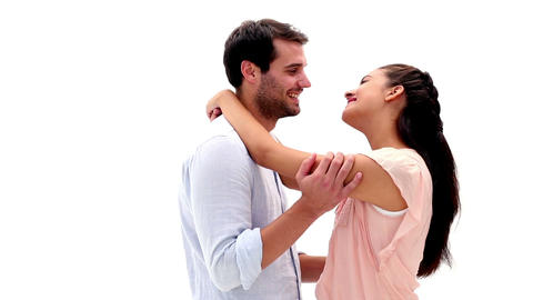 Attractive young couple hugging and smiling at cam Footage