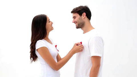 Attractive young couple supporting aids awareness Footage