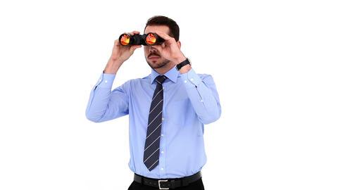 Young businessman looking through binoculars Footage