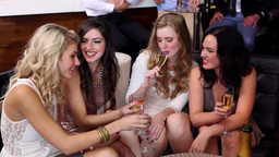 Female friends enjoying champagne together Footage
