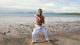 Fit shirtless man practicing martial arts Footage